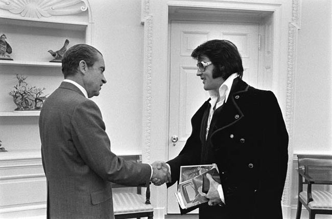 Boscutti - Elvis Presley - President Richard Nixon shakes hands with Elvis Presley in the oval office