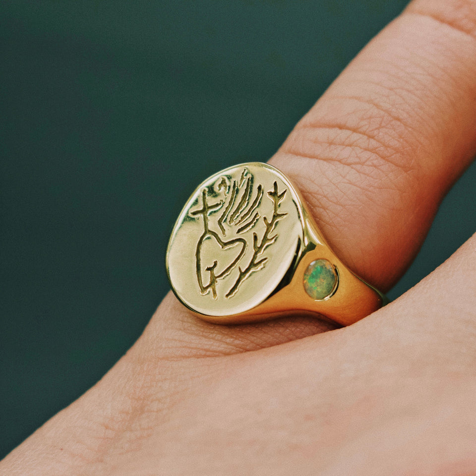 SACRED HEART AND WREATH CUSTOM ENGRAVED SIGNET RING WITH OPAL SET BAND, IN 9K YELLOW GOLD