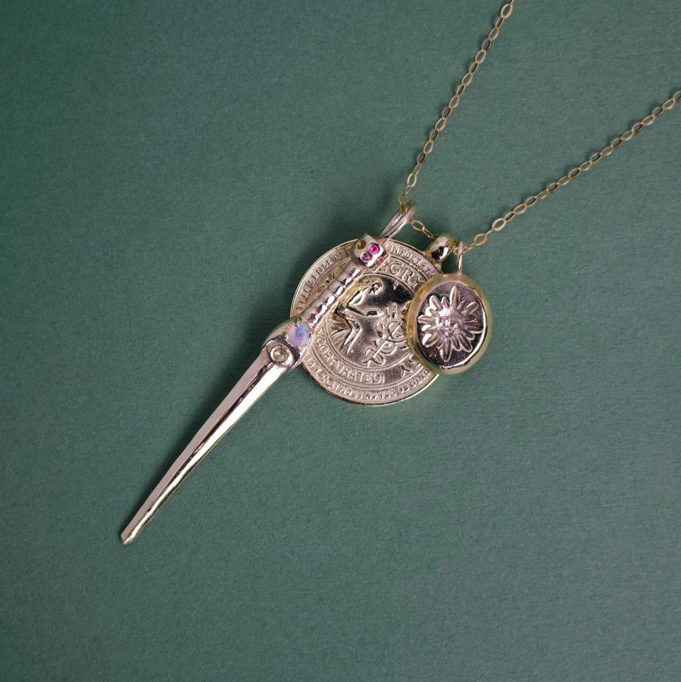CHARM NECKLACE WITH DAGGER, COIN AND SUN ENGRAVED PENDANT IN SOLID 9K YELLOW GOLD