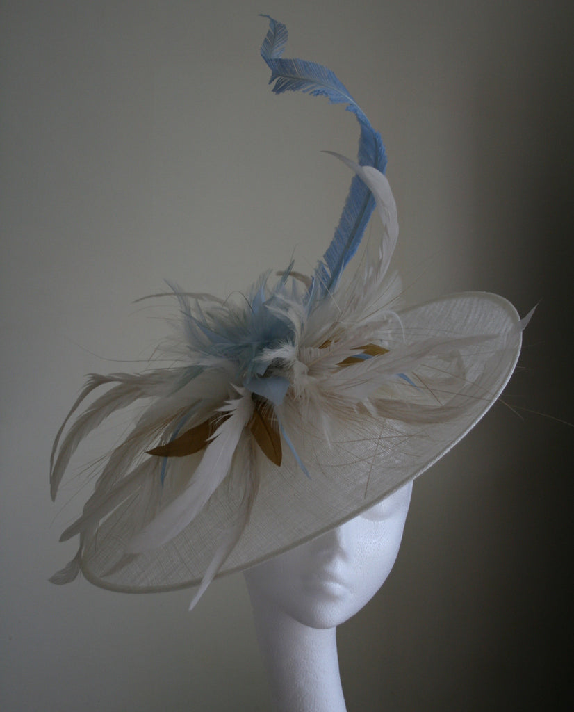 Ivory upturn headpiece with ivory and pale blue feathers from Andrea Neville-Rolfe Hats