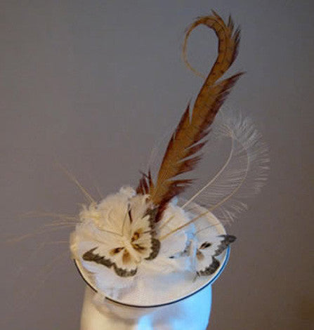 White small headpiece with brown trim, butterflies and feathers