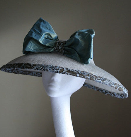 Large hat with lace and silk trim