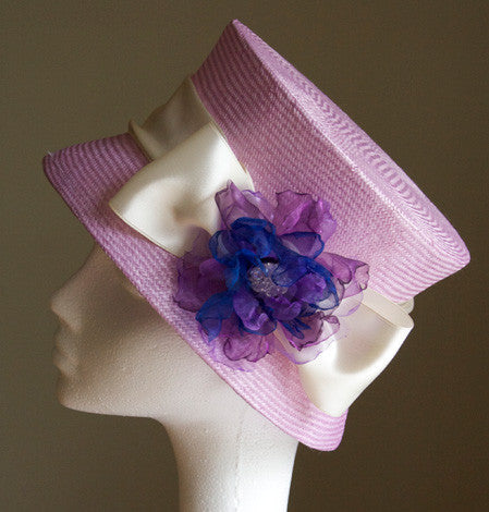 Pink cloche hat with satin ribbon and organza flower by Andrea Neville-Rolfe Hats