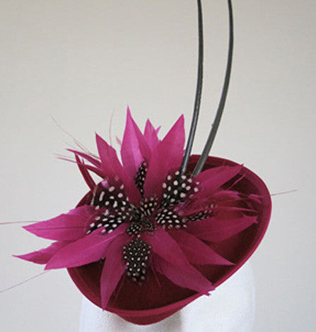 Magenta small headpiece with quills and feather flower from Andrea Neville-Rolfe Hats