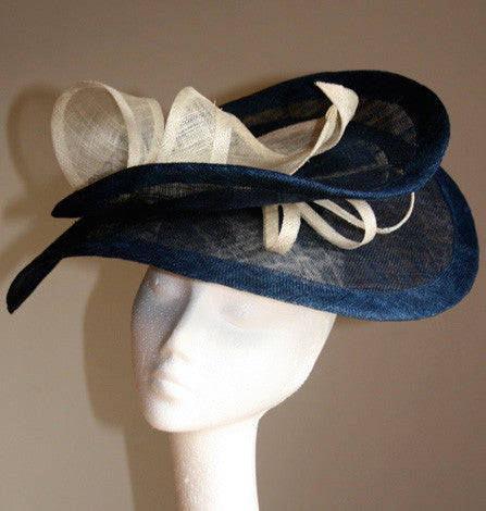 Navy and cream sinamay headpiece from Andrea Neville-Rolfe hats