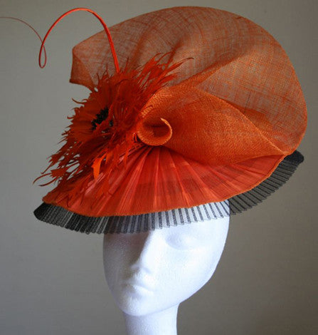 A striking orange and black sinamay headpiece