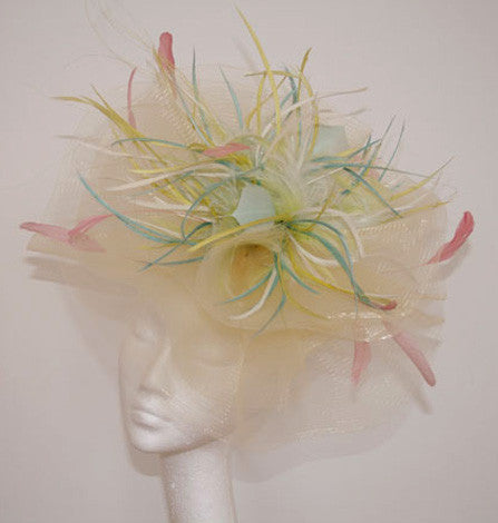 Pale crinoline headpiece with pastel feathers from Andrea Neville-Rolfe hats