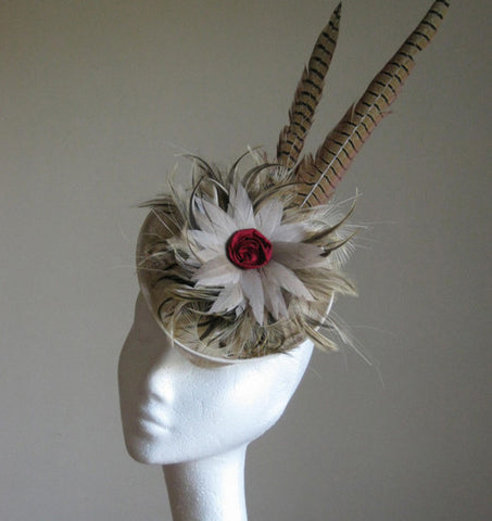 A stunning headpiece with pheasant feathers and small silk rose