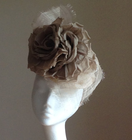 A beautiful, feminine headpiece with silk flowers