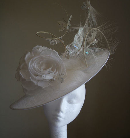 White sinamay headpiece with white roses, butterflies and quills