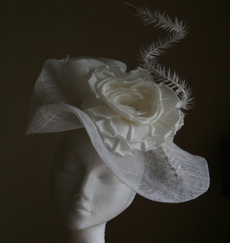 Beautiful white sinamay headpiece with a silk flower and quill