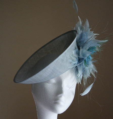 Small pale blue headpiece with feathers