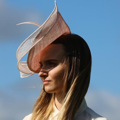 small headpiece in ivory sinamay with antique gold silk rose from Dorset based milliner Andrea Neville-Rolfe Hats
