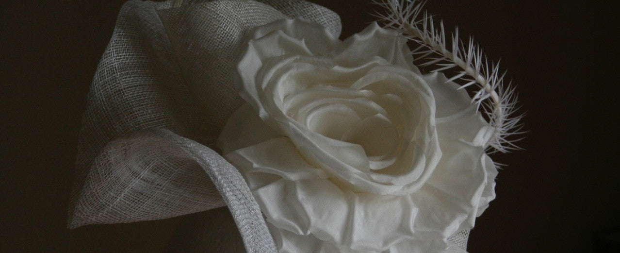 White headpiece with silk rose from Dorset based milliner Andrea Neville-Rolfe Hats