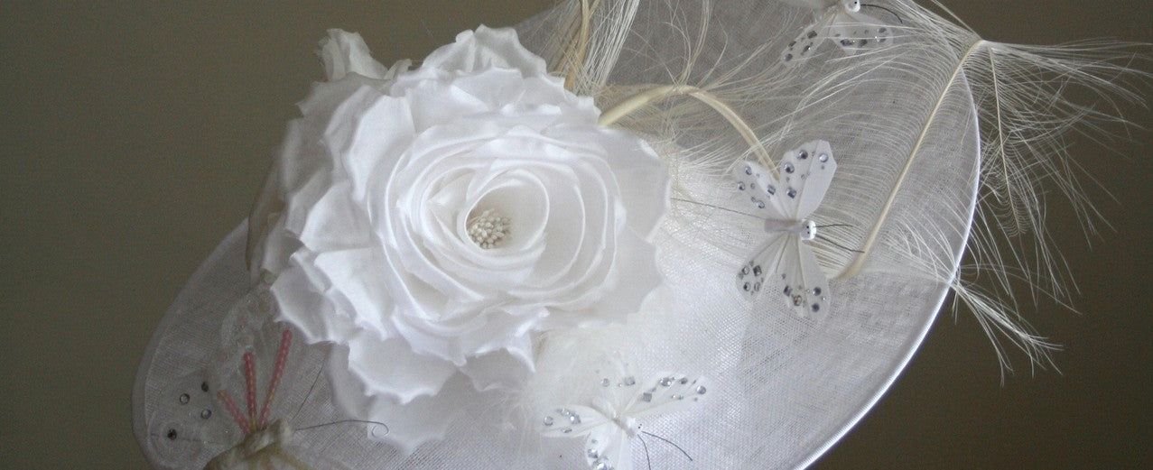 White hat with silk rose butterflies and feathers from Dorset based milliner Andrea Neville-Rolfe Hats