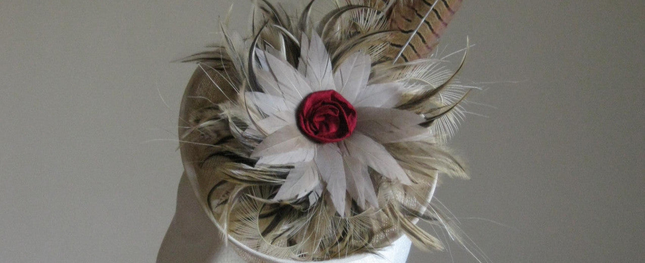 Small cream headpiece with pheasant feathers from Dorset based milliner Andrea Neville-Rolfe Hats