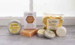 A variety of Hope Springs products: fizzies, soap, lotion bar, and body butter