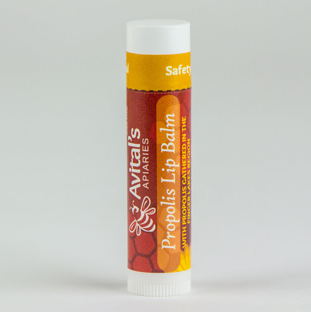 Single upright tube of Propolis Lip Balm with Reddish Brown label.