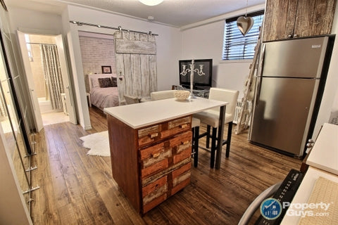 Custom built reclaimed teak wood with white patina  door & drawer panels  paired with  stainless steel appliance combines rustic warm wood with industrial chic.