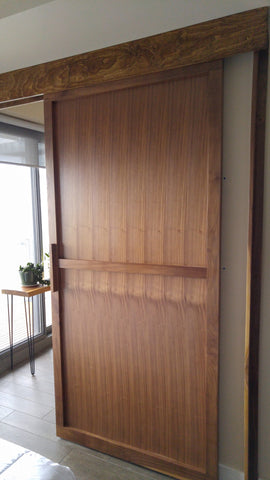 Walnut sliding door featuring top of the line hardware to make it smoothest sliding door.