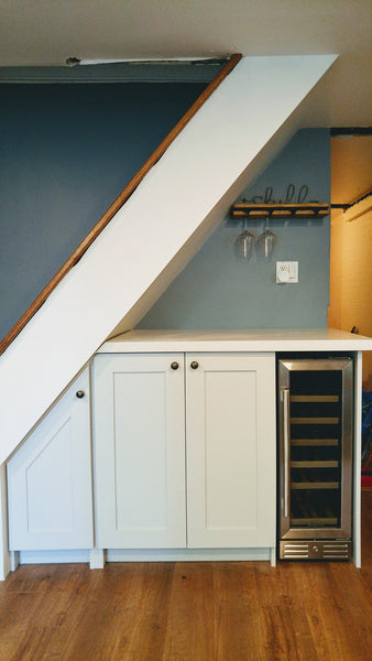 Every home can use more storage. Fortunately, the often-neglected space beneath a staircase provides an ideal spot for drawers and cabinets. This stylish example of under stair storage, offers space not only storage space but also a spot for a wine freezer and a counter top to display items or use it as a bar.