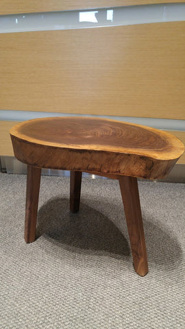 Walnut wood top came from our clients backyard when the tree was taken down , paired with sleek tapered solid walnut legs it has turned into an amazing end table for her new condo