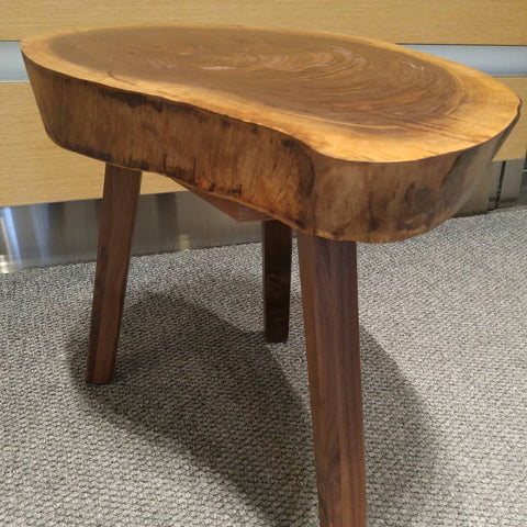 End table with a live edge walnut top and tapered solid walnut legs