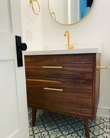 "Custom build  MCM inspired 30"" solid walnut wood vanity​ cabinet​, featuring a ​soft closing drawer ​and​ solid wood tapered legs. ​ ​With sturdy gold handles adding timeless touch to cabinetry  An elegant addition to any bath space, unique and beautiful texture​d walnut wood makes ​​bathroom classic,​ ​luxurious​ and stunning.  -Custom build  -Built from solid walnut wood  -Tapered legs  -Soft closing drawers ​  - 30"" x 22 "" x 33"" (ht)"