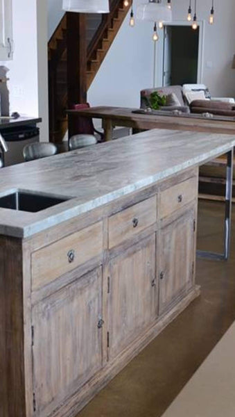 Rustic redefined !!  We designed this stunning island for Marnie's Muskoka home with help of designer Christina Tofan.  A one of a kind  cabinet built from reclaimed teak wood was turned into an island by attaching a custom made metal frame onto it's back.