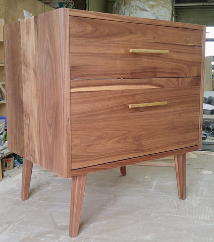 "Custom build  MCM inspired 30"" solid walnut wood vanity​ cabinet​, featuring a ​soft closing drawer ​and​ solid wood tapered legs. ​ ​With sturdy gold handles adding timeless touch to cabinetry  An elegant addition to any bath space, unique and beautiful texture​d walnut wood makes ​​bathroom classic,​ ​luxurious​ and stunning."