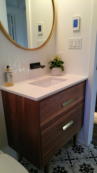 "Custom build 30"" solid walnut wood vanity​ cabinet​, featuring ceramic ​under-mount​ sink and white quartz countertop, ​soft closing drawers ​and​ solid wood tapered legs. ​ ​ An elegant addition to any bath space, unique and beautiful texture​d walnut wood makes ​b​bathroom classic,​ ​luxurious​ and stunning."