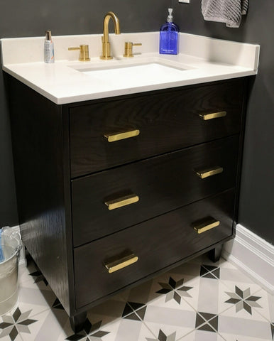 "Custom build vanity cabinet. - Oak wood drawer fronts - A fixed panel & 2 under mount drawers with cut out for plumbing - 30"" W x 20"" D x 33.5"" (ht)"