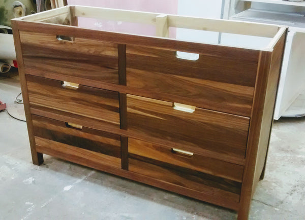 Solid walnut wood custom build vanity cabinet with 6 flat panel inset drawers.