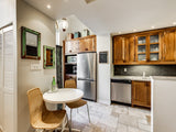 A bright & spacious reclaimed wood Inde-Art kitchen in a multi-level town home in the heart of downtown.