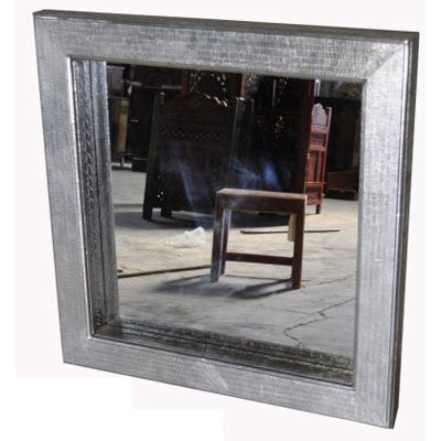 Solid wood mirror frame covered with  stamped sheet metal.