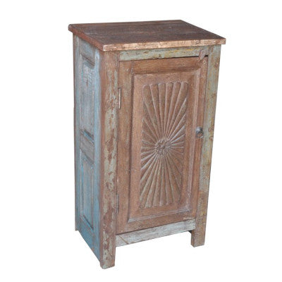 Solid reclaimed wood cabinet with  salvaged side panels and hand carved door.
