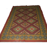 Hand woven woolen  rug in assorted colors and designs