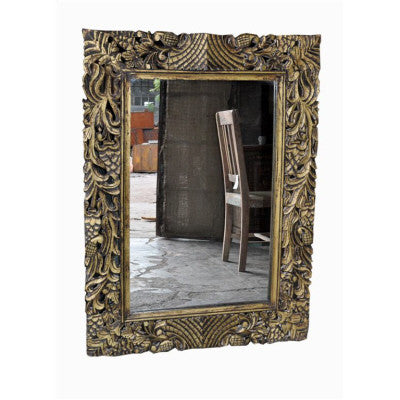 Hand craved solid wood mirror frame in gold color.