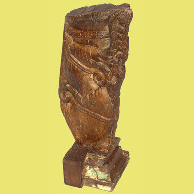 Mounted hand carved solid teak wood bracket.