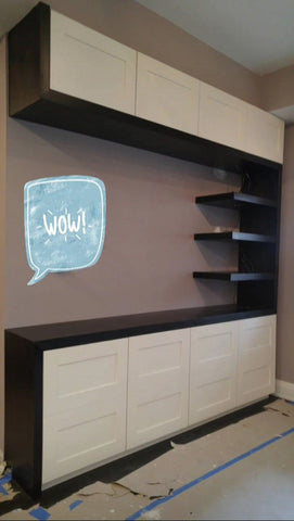 Modern & contemporary living room TV unit with lots of  storage and floating shelves.