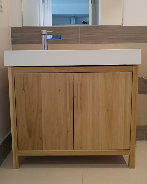 "This gorgeous clean line bathroom vanity cabinet.  Custom designed & built to fit an existing floating vanity top.  Frame & door panels built from solid polar wood,  -34"" x 20 "" x 28"" (ht)"