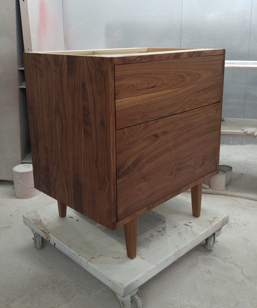 "Custom build  MCM inspired 30"" solid walnut wood vanity​ cabinet​, featuring 2 ​soft closing drawer ​and​ solid wood tapered legs. ​ ​  An elegant addition to any bath space, unique and beautiful texture​d walnut wood makes ​​bathroom luxurious​ly stunning.  -Custom build  -Built from solid walnut wood  -Tapered legs  -Soft closing drawers ​  - 30"" x 22 "" x 33"" (ht)"