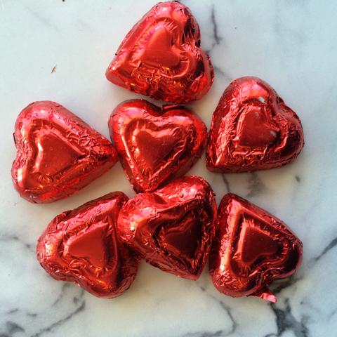 Red Foil wrapped hearts, milk chocolate, about 50 pieces per lb