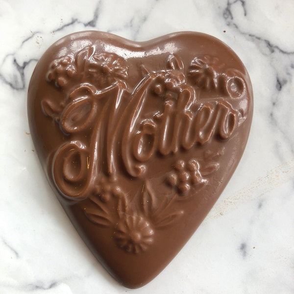 A chocolate heart for mother. Heart measures 4 inches across. Delicious, solid chocolate Mother's Day Gift