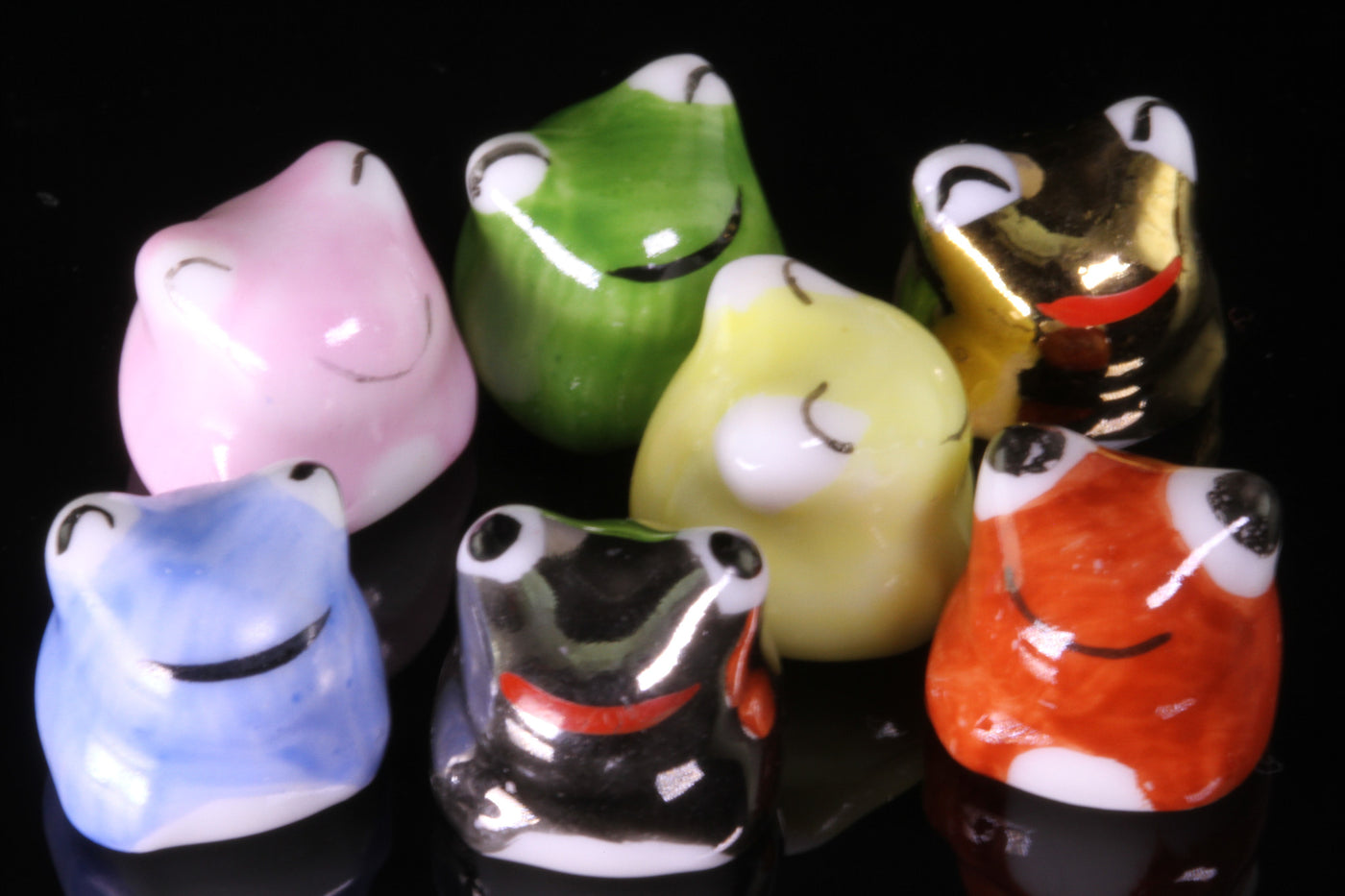 Set of Seven Porcelain Frogs