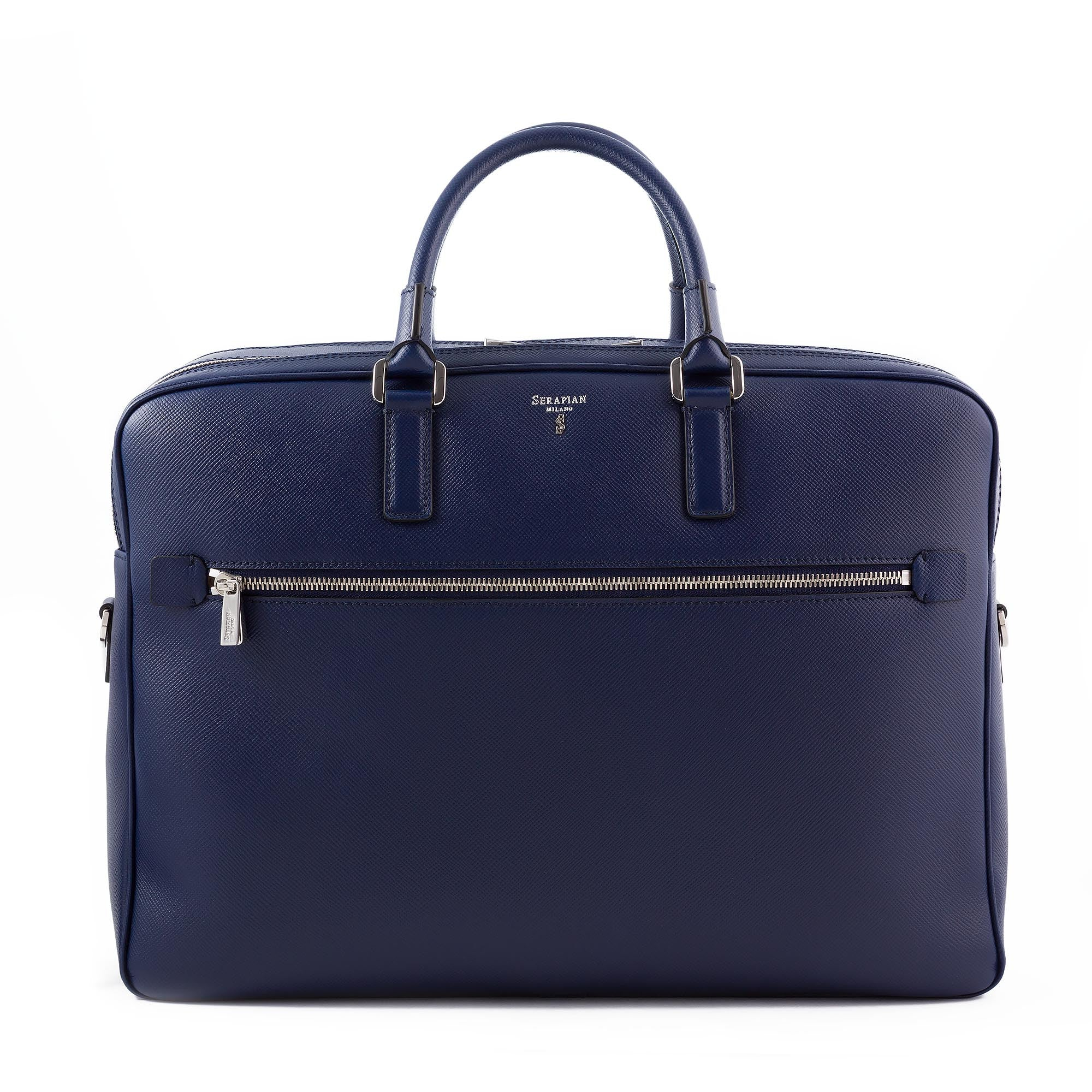"double briefcase in scratch and water resistant evolution leather. Lined inside with a microfiber suede, two compartments that hold papers, books and a laptop up to 15"". Attachable shoulder strap with attached strap on back to fit easily on to a wheel trolley. New klein blue color with silver hardware"