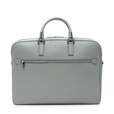 "double briefcase in scratch and water resistant evolution leather. Lined inside with a microfiber suede, two compartments that hold papers, books and a laptop up to 15"". Attachable shoulder strap with attached strap on back to fit easily on to a wheel trolley. Beautiful light grey cement color with silver hardware"