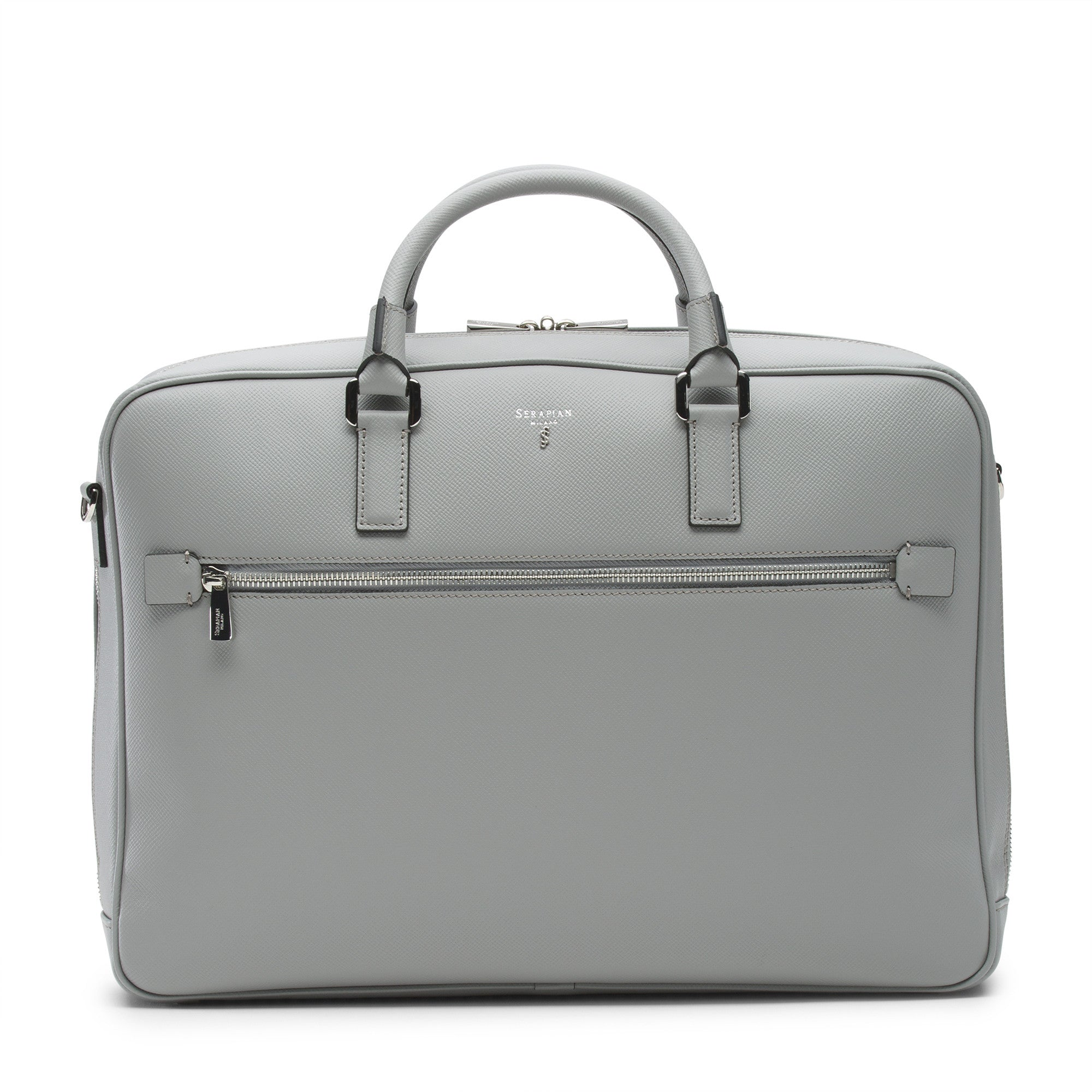 "Single briefcase with zip in scratch and water resistant light grey evolution leather. Attachable shoulder strap plus attached strap on the back to easily slip onto a wheeled trolley. Lined inside with microfiber suede, inside zippered pocket. Can hold up to a 15"" laptop."