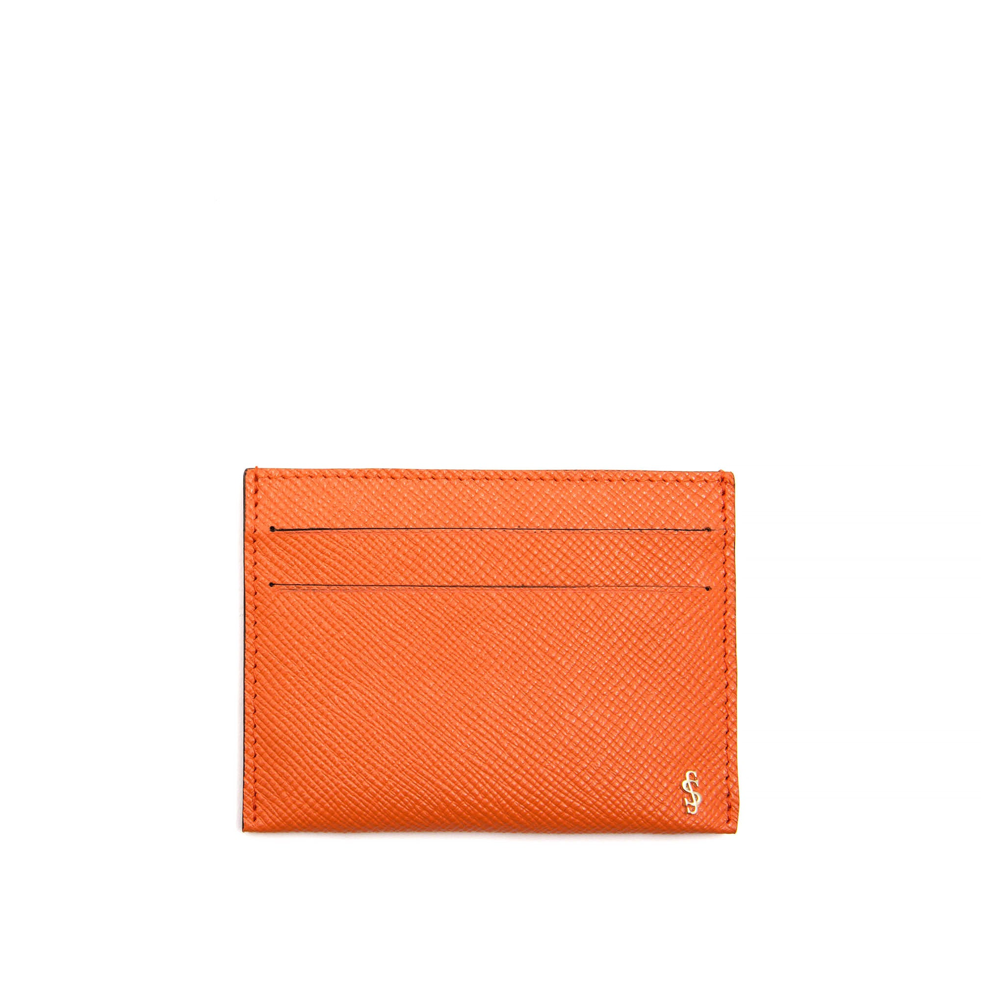 The simple card case in scratch and water resistant, flame orange evolution leather. Tiny enough to carry in your pocket or your bag. Slots on each side for # credit cards and an opening in the middle for a key or dollars.