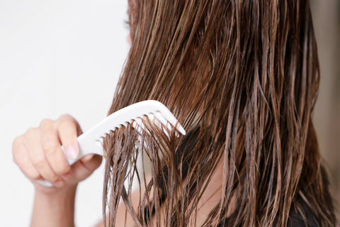 woman combing wet hair